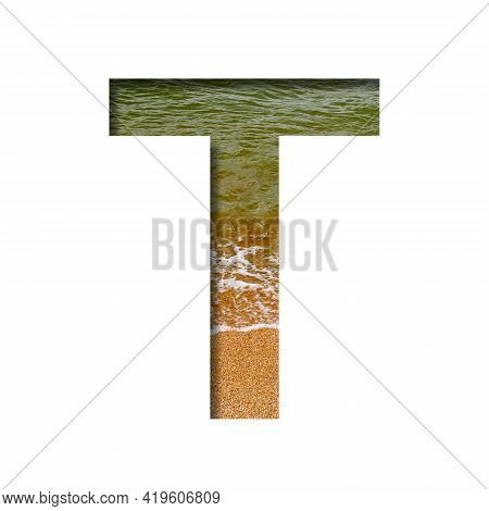 Sea Shore Font. The Letter T Cut Out Of Paper On A Background Of The Beach Of Seashore With Coarse S