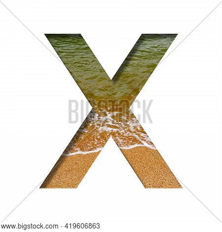 Sea Shore Font. The Letter X Cut Out Of Paper On A Background Of The Beach Of Seashore With Coarse S