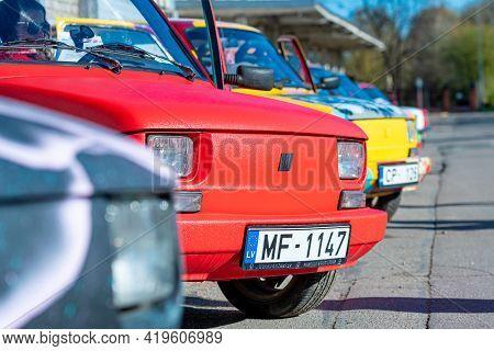 Riga, Latvia - May 01, 2021: Line Of Colorful Stylish Vintage Fiat 126 Pancars Rental Cars, Pancars