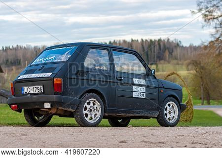 Madona, Latvia - May 01, 2021: Colorful Oldtimer Pancars Rental Car Fiat 126 Parked On The Side Of A
