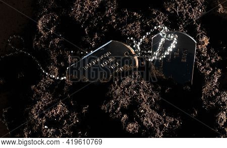 Military Token, Army Token Lying On A Pile Of Soil