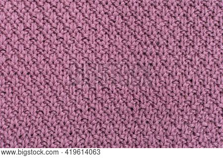 Knitted Fabric Pearl Woolen Background. The Structure Of The Fabric With A Natural Texture. Fabric B