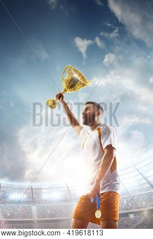 Soccer Winner. Professional Soccer Player Celebrates Winning The Open Stadium. The Winner Of The Soc