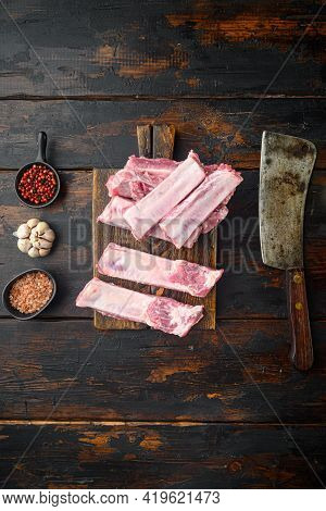 Raw Pork Meat Ribs Set, And Old Butcher Cleaver Knife, On Old Dark  Wooden Table Background, Top Vie