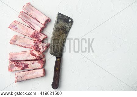 Pork Rib Set, And Old Butcher Cleaver Knife, On White Stone  Background, Top View Flat Lay, With Cop