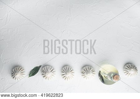 Uzbek Manti. Manti Or Manty Dumplings, Popular Uzbek-asian Dish Set, On White Stone  Surface, Top Vi