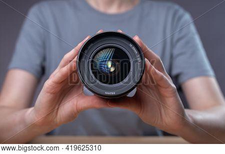 Modern Digital Camera Lens In Hands Of Female Photographer