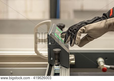 A Carpenter Works On A Woodworking Machine. A Carpenter Works On Woodworking Machines In A Carpentry