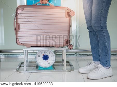 Female Hand Holding The Luggage Suitcase Weighting On The Kilo Scales For Check The Weight Prepare C