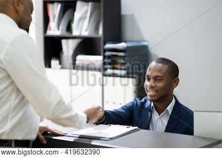 African Client At Hotel Reception Cashier Counter