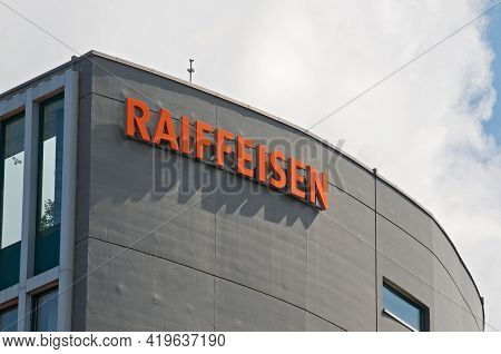 St. Gallen, Switzerland - 14th April 2021 : Raiffeisen Bank Sign Hanging On The Headquarters Buildin