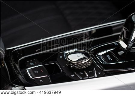 Gear Shift Controller In New Luxurious Car Interior Near Automatic Gearbox Handle Close Up View.