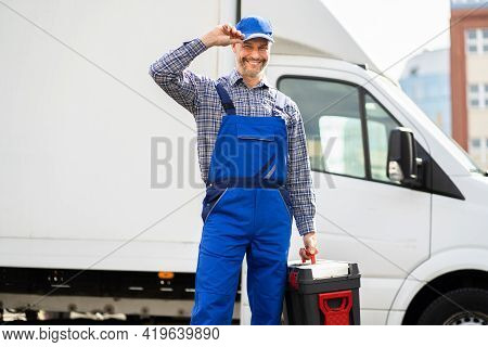 Happy Technician Service In Overall Near Van Or Truck