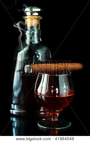 Glass And Bottle With Cognac