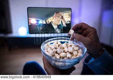 Enjoying Popcorn Snacks Watching Tv Or Television On Sofa
