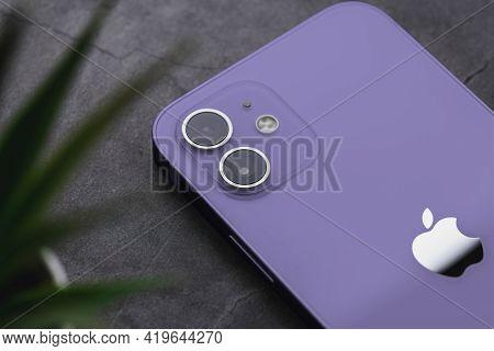 Antalya, Turkey - May 06, 2021: Back View Of New Iphone 12 Purple Smartphone