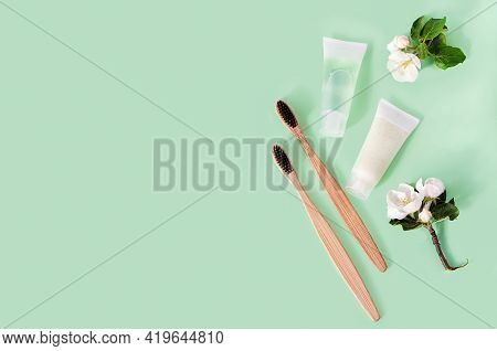 Bath Accessories Zero Waste In Eco-friendly Home, Herbal Toothpaste, Bamboo Toothbrush On Green Back