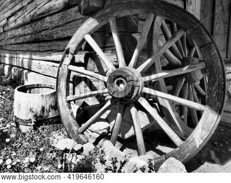Wooden Wheel From A Cart. Decorative Wheels For Decorating Lawns, Exteriors And Rustic Interiors. Ro
