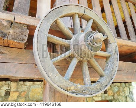 Wooden Wheel From A Cart. Decorative Wheels For Decorating Lawns, Exteriors And Rustic Interiors. A
