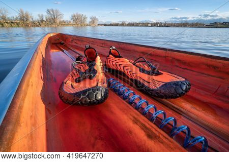 lightweight low-profile water shoes for kayaking and other wet sports on a deck of a stand up paddleboard