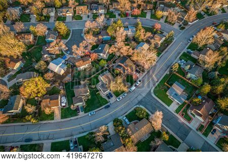 street in a residential area of Fort Collins in northern Colorado - early morning aerial view in springtime
