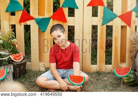Amusing Boy Eating Watermelon In The Summer Outdoor. Healthy Snack For Children. Funny Happy Child E