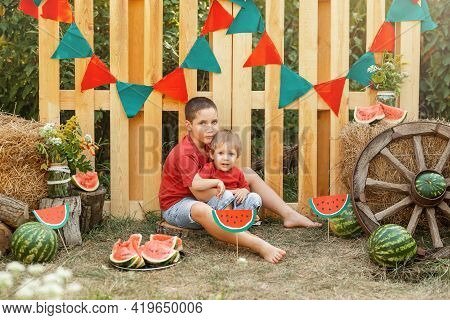 Two Little Cute Boys Enjoying Watermelon. Children Having Picnic In Summer. Children Play And Eat Wa
