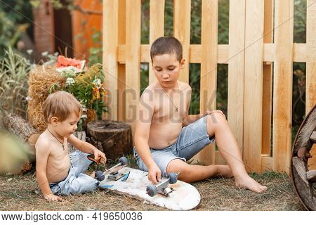 Funny Activity Game For Kids On Playground Outside. Cute Adorable Children Boys Friends Playing Outd