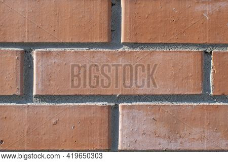 Background, Texture, Pattern Of Smooth, Geometrically Adjusted Neat Red Brick With Traces Of Fresh,