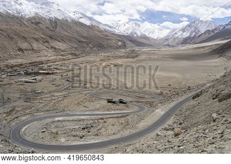 Winding Curvy Rural Road With Light Trail From Headlights Leading Through Ladakh In India.