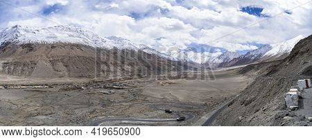 Panorama Shot Of Mountains And Blue Sky With Covered Clouds, Barren And Deserted Land In Ladakh.