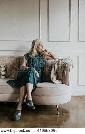 Classy senior woman sitting on the couch