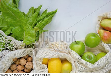 Eco Shopping Bags.farmed Organic Fruits And Vegetables. Reusable Eco-friendly Bags. Green Apples,man