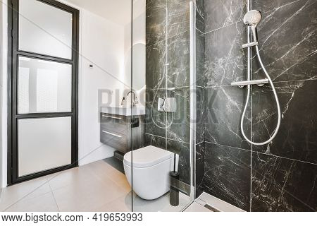 Shower And Toilet Near Sink In Contemporary Bathroom Designed In Minimal Style In Apartment