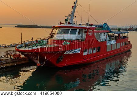 Daecheon, South Korea; April 25, 2021: Big Red Cruise Ship Moored At Dock In Seaport At Sunset.