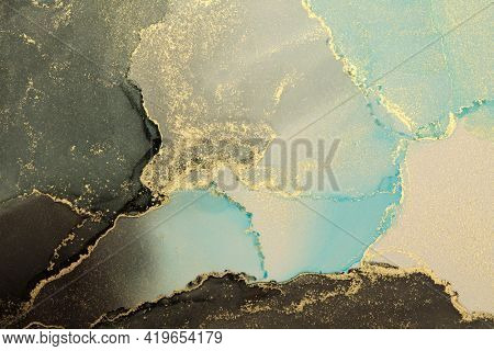 Art Abstract painting blue, black and gold blots horizontal long background. Alcohol ink colors. Marble texture.