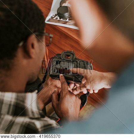 Photographer checking a preview photo