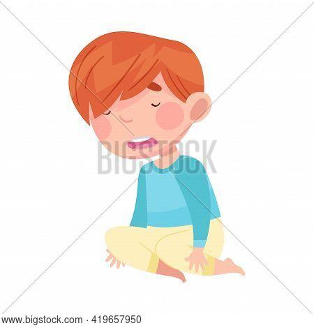 Sleepy Little Boy Wearing Pajamas Sitting On The Floor And Yawning Vector Illustration