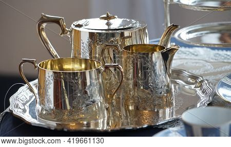 Pots And Other Silverware On The Table
