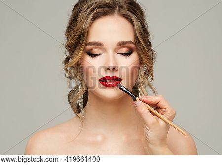Make Up Artist Apply Red Lipstick. Beauty Woman Model Put On Lip Gloss. Close Up Portrait Of Profess