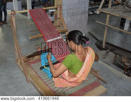 An Assamese  Woman Weaver Uses A Loom To Make A Hand Woven Saree At Workshop