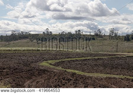 Freshly Ploughed Farmland On Cloudy Overcast Day
