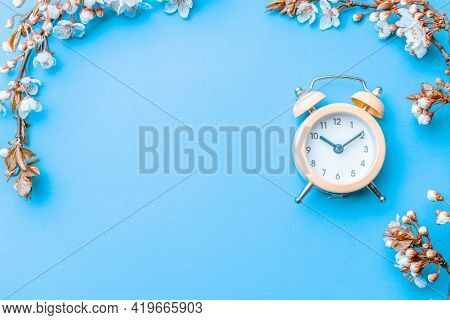 May Flowers. Spring Blossom And April Floral Nature With Alarm Clock On Blue Background. Beautiful S