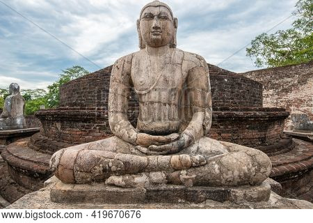 The Ancient Stone Buddha On The Upper Platform In The Vatadage, Ancient City Of Polonnaruwa. Polonna