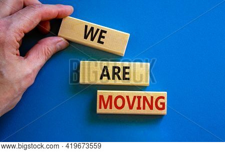 We Are Moving Symbol. Wooden Blocks With Words 'we Are Moving'. Beautiful Blue Background, Businessm