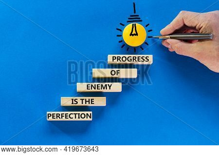 Perfection Or Progress Symbol. Wooden Blocks On Blue Background, Copy Space. Light Bulb Icon. Busine
