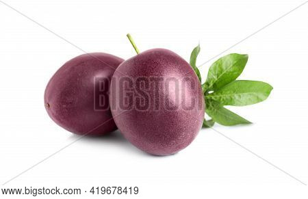 Ripe Passion Fruits With Leaf Isolated On White