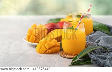 Fresh Beautiful Delicious Mango Juice Smoothie In A Glass Cup On Gray Table Background.