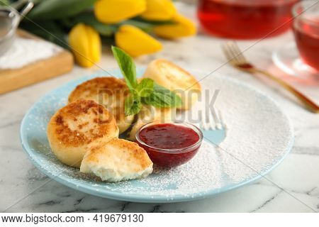 Delicious Cottage Cheese Pancakes With Jam, Mint And Icing Sugar On White Marble Table