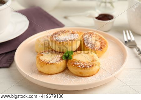 Delicious Cottage Cheese Pancakes With Mint And Icing Sugar On White Wooden Table